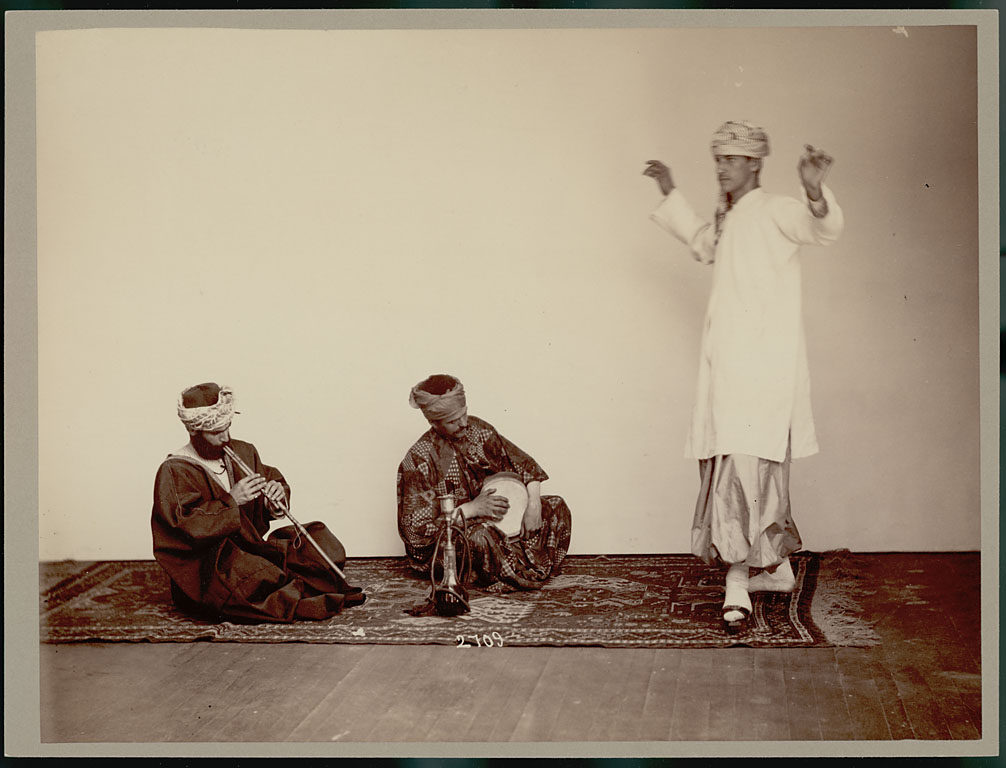 """Three Arbeely brothers performing in """"native dress."""" Washington, DC, ca.  1883. National Anthropological Archives of the Smithsonian Institution."""