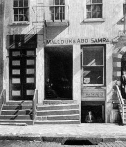 Mallouk & Abo Samra Dry Goods and John Haddad's Grocery in basement, 77 Washington, 1904
