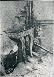 Hall sink in Washington Street tenement, 1914